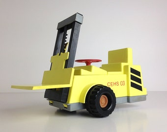 Soviet Toy / Yellow Robot - Fork Lifter / Straume Factory / USSR  /  Latvia / 80s