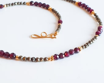 Sparkling garnet necklace with pyrite and gold plated sterling silver elements garnet faceted