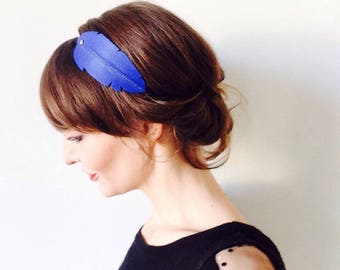 "Head band made of molded cobalt blue leather ""Feather"" mounted on elastic decorated with a gold Stud"