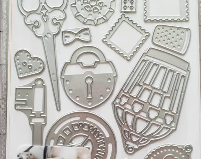 Cuttlebug Lost & Find 16 Piece Embossing Die Set
