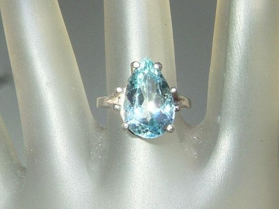 Pear Blue Topaz Solitaire