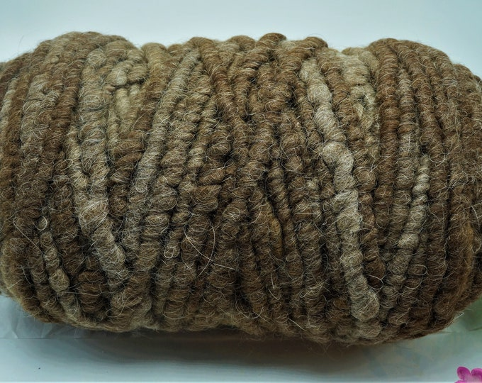 Bulky 100 % Alpaca Rug Yarn Bump  100+/- yards shades of brown and beige.  Core spun.  Fiber from the alpacas that call our farm their home