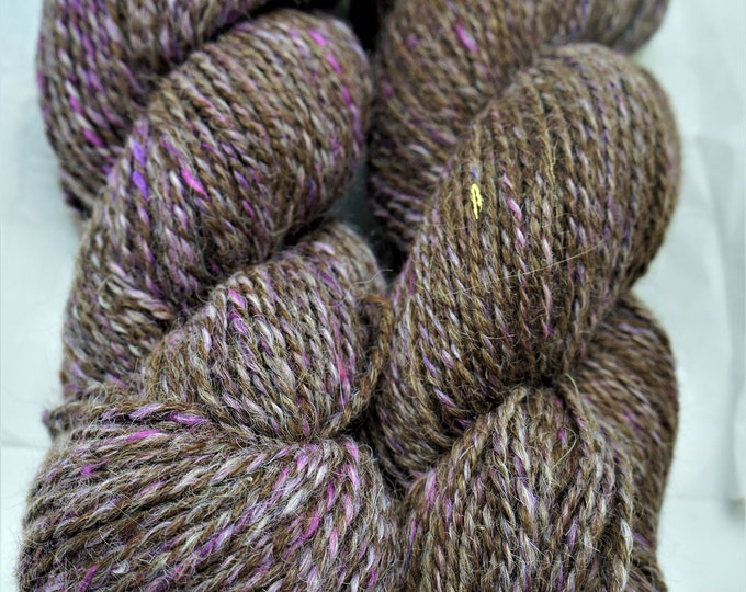 Alpaca Yarn blended with Mulberry Silk in mauve for a silky feel 200 yds per skein-2 ply From the Huayaca and suris at the farm
