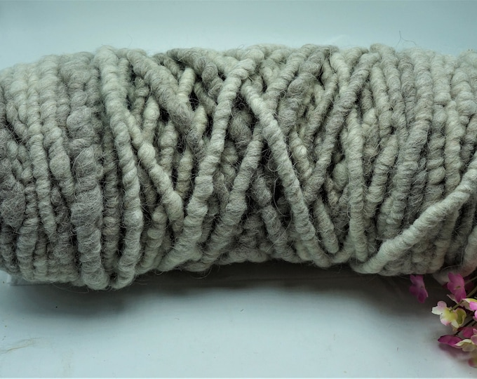 Bulky 100 % Alpaca Rug Yarn Bump  100+/- yards shades of white and gray.  Core spun.  Fiber from the alpacas that call our farm their home