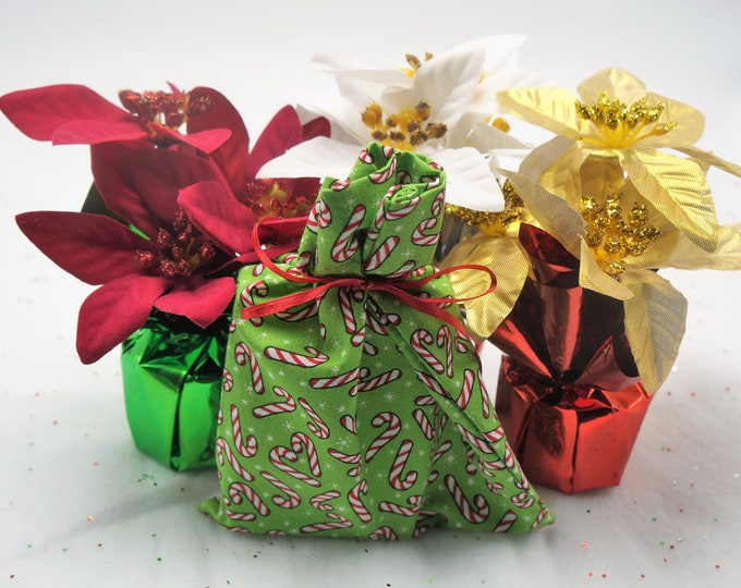 Goat milk and shea butter bar soap in a festive, reusable Christmas bag-  moisturize cleanse - great for the skin