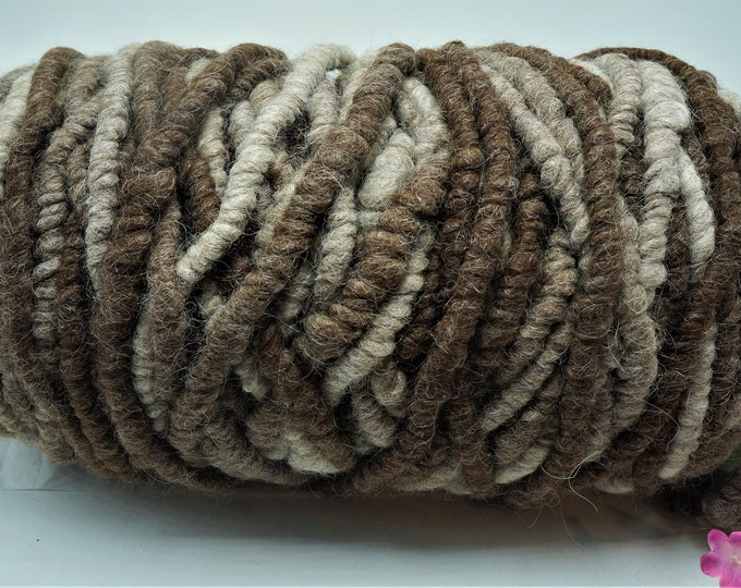 Bulky 100 % Alpaca Rug Yarn Bump  100+/- yards shades of brown and white.  Core spun.  Fiber from the alpacas that call our farm their home