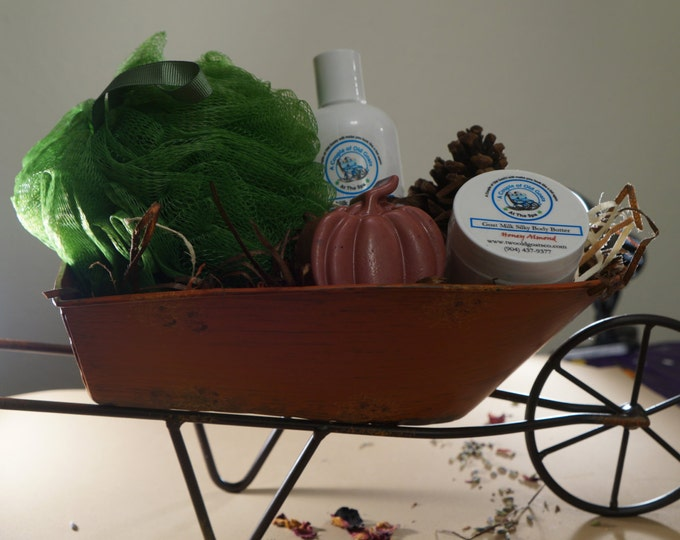 The Autumn Wheelbarrow filled with  Goat Milk products Goat Milk & Honey Lotion Fun Goat Milk Pumpkin Soap Goat Milk Silky Body Butter