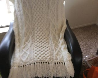 Soft and warm knitted throw.