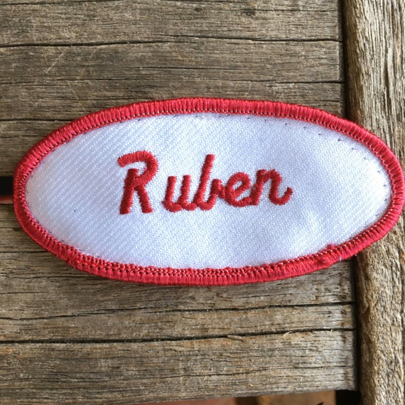 "Ruben. A white work shirt patch that says ""Ruben"""