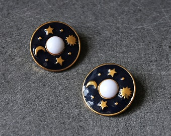 A vintage enameled clip, Moon and Sun earrings