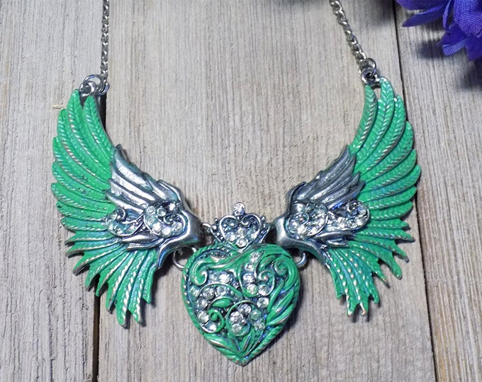 large handpainted patina necklace featuring wings and heart in silver tone metal