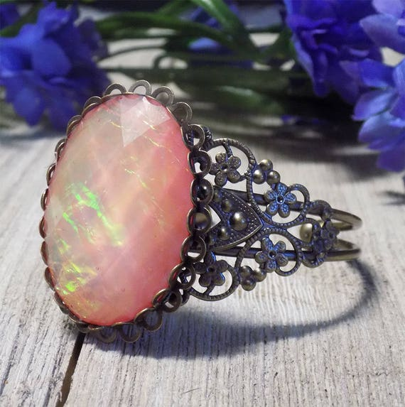Victorian style filigree cuff bracelet with faceted acrylic rose opal cabochon