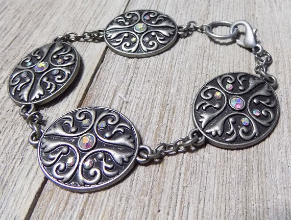 dark antique silver tone bracelet with four ornate Victorian style connectors and lobster clasp closure