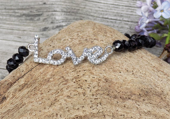 handmade black beaded love bracelet