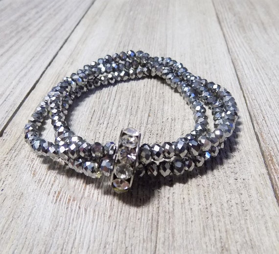 silver tone multi strand stretch beaded bracelet with faceted beads