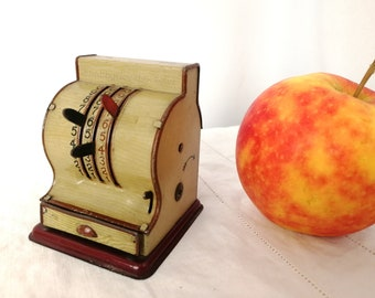 Old tin toy cash register with operating drawer, made in 1920s Germany by Anfoe, antique toy shop tin register