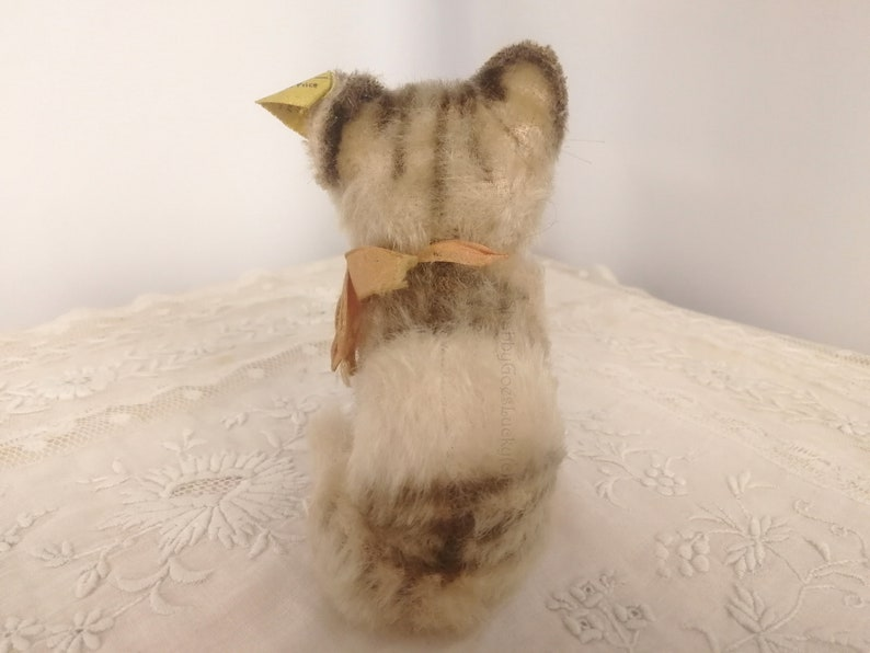 bow Vintage Steiff cat Susi with original Steiff button smallest 4 inch edition label sitting mohair tabby bell produced 1959 \u2013 1964