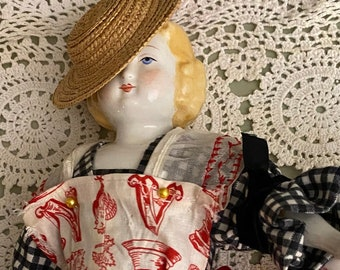 Antique China head doll. 13 inches darling clothes.  She is blonde with sausage curls- Civil War era