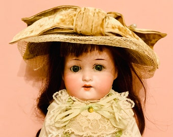 Antique German doll. 15 in. cabinet sz.  Heubauh 275. 9/0. Pretty antique clothes. French human hair wig.