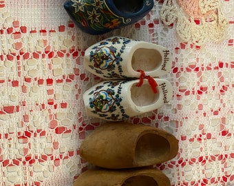 Antique doll shoes -clogs from Holland.  2 porcelain, one hand carved wood.  Antique doll