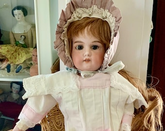 Antique German bisque doll- lovely antique clothes.  22 inches- human hair LONG wig