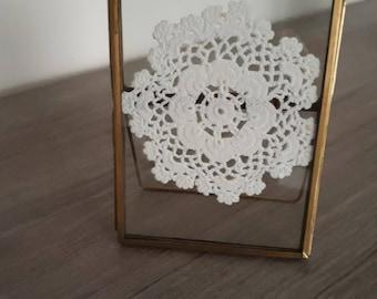 Framed crocheted vintage doily