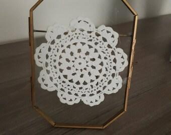 Framed crocheted doilie