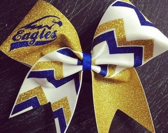 a59d5b4dbcc4 Eagles gold , white and royal blue glitter chevron cheer bow.