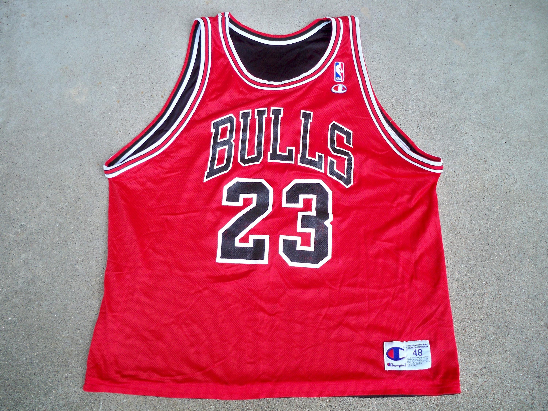 8a11bb18a9ab Vintage Champion Reversible Chicago Bulls Michael Jordan 23