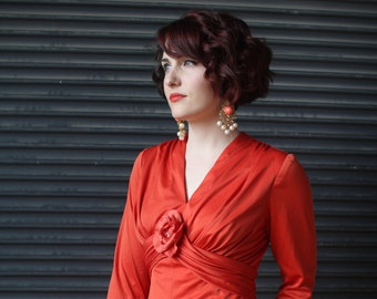 Vintage coral jersey dress with deep V and rosette, 1970s