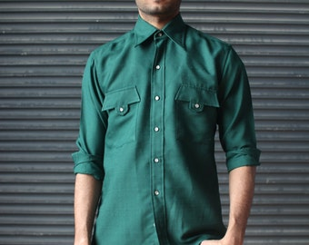 Vintage forest green mens shirt in textured polyester, Pierre Cardin, 1970s