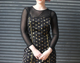 Vintage fitted cocktail dress with sheer detail in black and gold,1980s