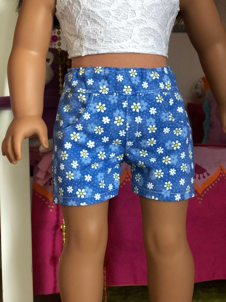 Blue front  pocket shorts with a small daisy print. 18\u201d  doll clothes 18 inch