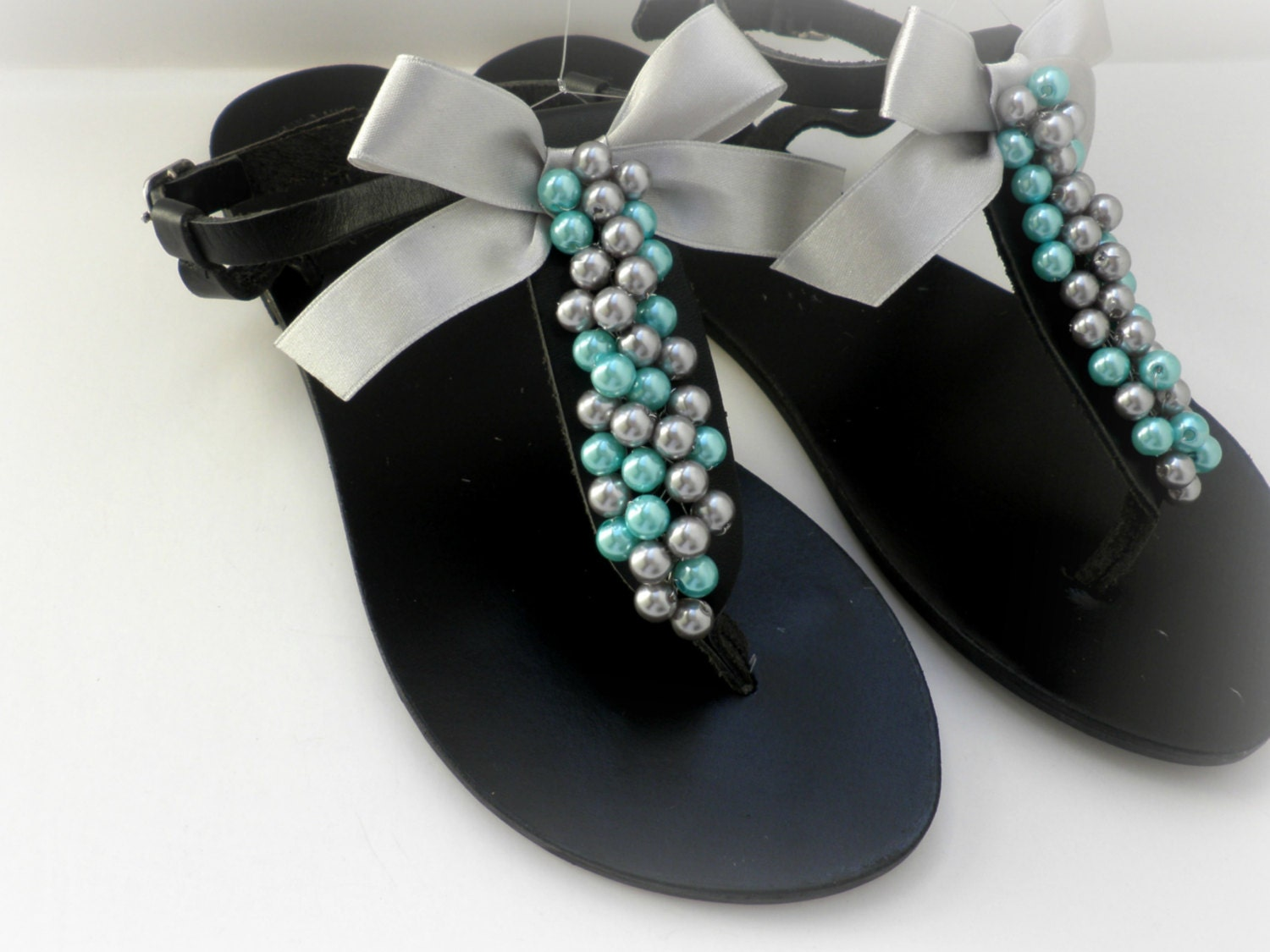 1080044abf0 Black leather sandals decorated with mix silver turquoise pearls and silver  satin bow
