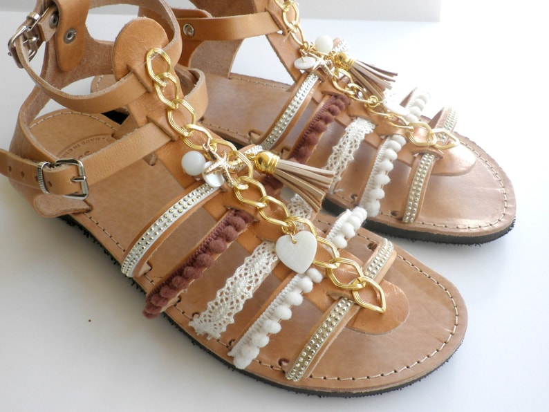 b7ac8c3bab9abb Bohemian leather sandals with pompom gold chain Decorated