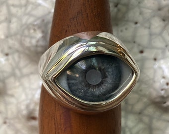 Size 8.75 Hand painted blind blue eye set in a 999 sterling silver ring setting