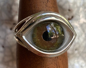 Size 9.25 hand painted hazel eye in a sterling silver setting