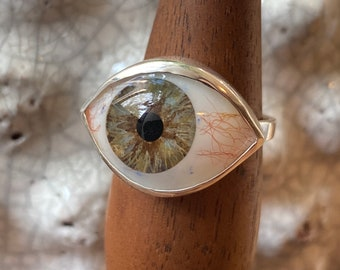 Size 9 aged blue brown eye set in sterling silver ring setting