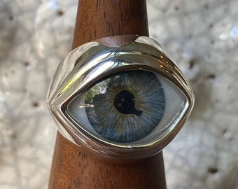 Size 5 Hand painted aged blue with damaged pupil set in a 999 sterling silver ring setting
