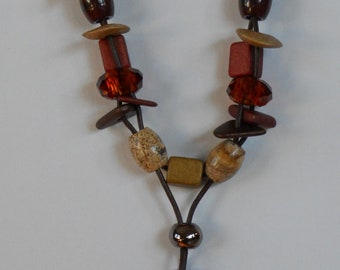 Rust and cream terra pendant and beaded leather necklace