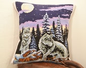 Handmade pillow cushion with vintage embroidery of two wolves in the forest