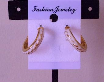 Gold tone and enamel hoop earrings on  post.