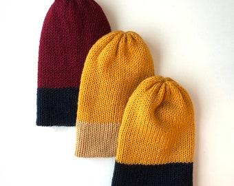 Divu krāsu Cepure Hermaņa atbalstam (Pusvilna)