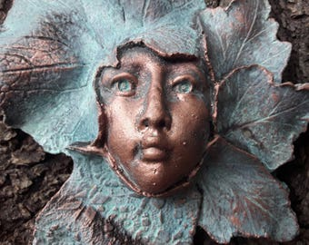 Art for your garden wall, fence and gate, handcrafted sculpture of a female face surrounded by leaves.  Autumn I by Gable Gargoyles