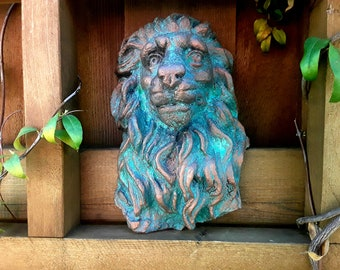 Garden lion wall, fence or gate bronze and patina sculpture for your home inside or outdoor.