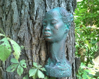 Bronze aged patina African woman's face for wall, fence, gate artwork.