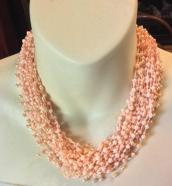 Vintage 1950's pink multistrand sugar crumb beads
