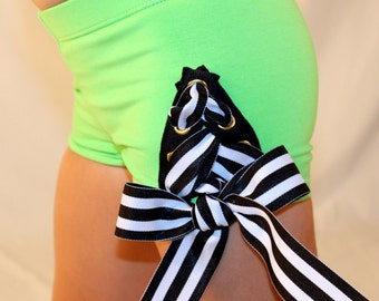 Girls dance clothes, dancewear, lace-up shorts, cheer shorts, green with grommets with black and white grosgrain ribbon