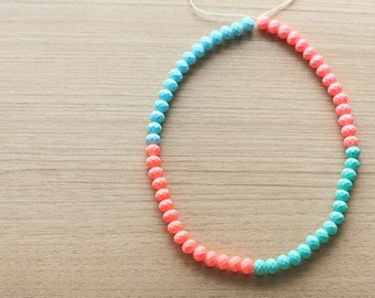 60 pcs of Matte Salmon , blue, turquoise and Orangish Pink Dyed Faceted Rubber Beads - 6 x 8 mm