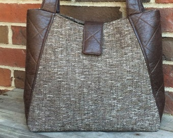 Brown tweed fabric with quilted faux leather sides and straps